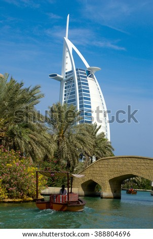 DUBAI, UNITED ARAB EMIRATES - NOVEMBER 10, 2012: View of Burj Al Arab hotel from Madinat Jumeirah hotel. Madinat is a luxury resort which includes hotels and souk covering an area over 40 hectars. - stock photo