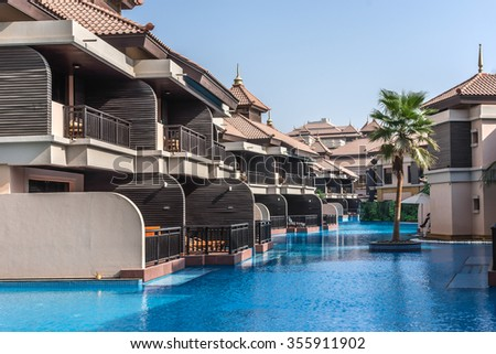 DUBAI, UNITED ARAB EMIRATES - SEPTEMBER 10, 2015: Anantara Dubai the Palm Resort & Spa (260 luxury suites, penthouses and villas) on man-made Island of Palm Jumeirah. Pools and villas. - stock photo