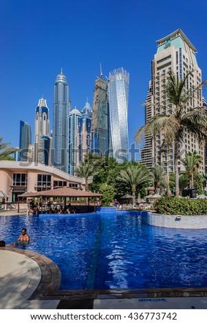 DUBAI, UNITED ARAB EMIRATES - SEPTEMBER 6, 2015: 5-stars Habtoor Grand Beach Resort & Spa (446 rooms) located on Dubai's legendary Jumeirah Beach, adjacent to Dubai Marina. Pool. - stock photo