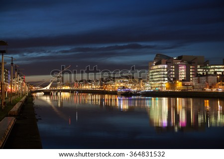 Dublin City Center during sunset with Samuel Beckett Bridge and river Liffey - stock photo