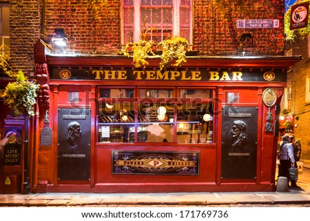 DUBLIN, IRELAND - APRIL 1 2013: Historic Temple Bar in Dublin, Ireland Temple Bar historic district.  This landmark medieval area is known as Dublin's cultural quarter with lively nightlife. - stock photo