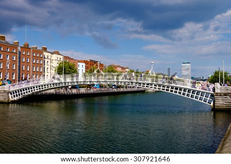 Dublin, Ireland. August 18, 2015. Ha'penny Bridge over the River Liffey. Liberty Hall in the background