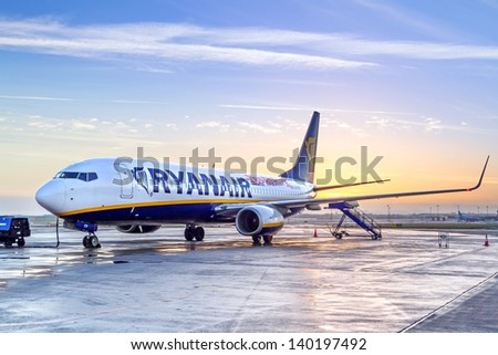 DUBLIN, IRELAND - 11 DEC 2010: Preparing for boarding to Ryanair plane in Dublin airport on 11 December 2010. Ryanair operates over 300 aircraft and is the biggest low-cost airline company in Europe. - stock photo