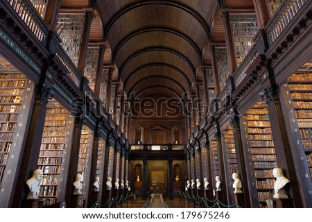 DUBLIN, IRELAND - FEB 15: The Long Room in the Trinity College Library on Feb 15, 2014 in Dublin, Ireland. Trinity College Library is the largest library in Ireland and home to The Book of Kells.  - stock photo