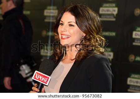 DUBLIN, IRELAND - FEBRUARY 20: Lisa Cannon - presenter of Xpose in Irish TV3 waiting to interviewing Al Pacino at Jameson Dublin International Film Festival, February 20, 2012 Dublin, Ireland - stock photo