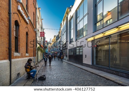 Dublin, Ireland - February, 15th 2015 - Big group of locals and tourist walking during the winter in the streets of downtown Dublin in Ireland.