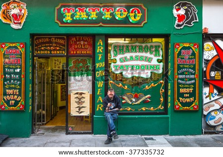 Dublin,  Ireland - July 31, 2013:   A tattoo shop in the Temple Bar quarter