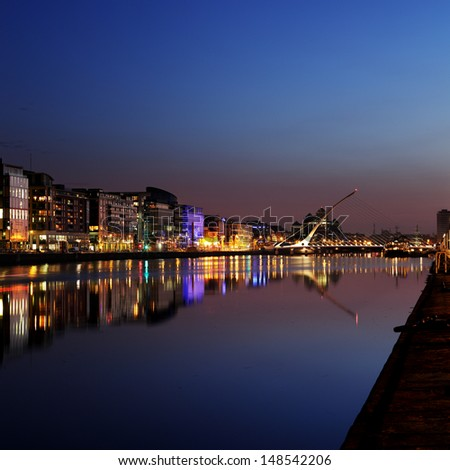 DUBLIN, IRELAND - JULY 22: Night skyline of the Dublin City Center on July 22, 2013 in Dublin, Ireland. Samuel Beckett Bridge on the river Liffey was designed by architect Santiago Calatrava