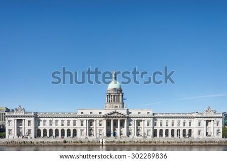 DUBLIN, IRELAND, JULY 31, 2015: The Customs House building in Dublin, Ireland along the River Liffey. - stock photo