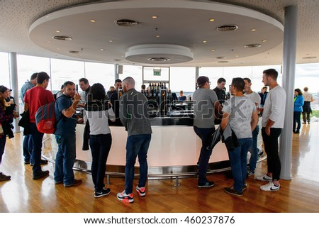 DUBLIN, IRELAND - JULY 12, 2016: Unidentified tourists drink a pint of Guinness at the museum in Dublin. Guinness is an Irish dry stout originated in the brewery of Arthur Guinness