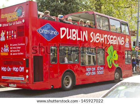 DUBLIN, IRELAND - MAY 25: a Dublin Sightseeing tour bus on May 25, 2013 in Dublin, Ireland. Dublin is a popular tourist destination with 6.5 million visitors from overseas in 2012 (source: ITIC). - stock photo