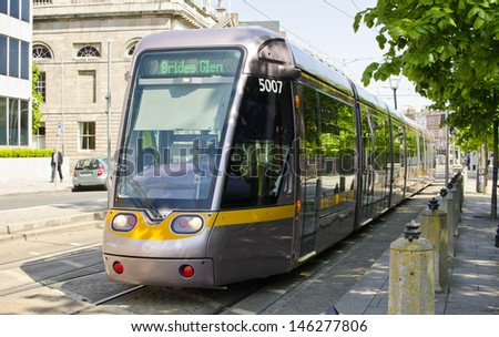 DUBLIN, IRELAND - MAY 25: a Luas tram on May 25, 2013 in Dublin, Ireland. The luas tram system opened in 2004 and carried 29.4 million passengers in 2012. - stock photo