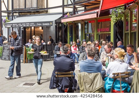 DUBLIN, IRELAND - 05 MAY, 2016: People drinking in a restaurant by the Guinness Storehouse. The place is one of the most visited Irish sites and contains many attractions distributed in seven floors