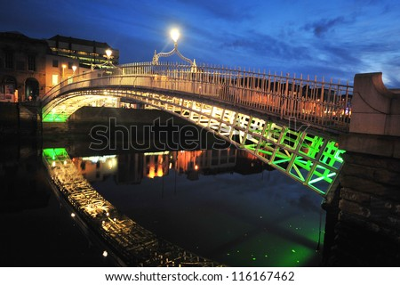 DUBLIN, IRELAND - OCTOBER 14 : Halfpenny Bridge on October 14, 2008, Dublin, Ireland. The bridge was built in 1816 and for 100 years a halfpenny toll was charged to cross it. - stock photo