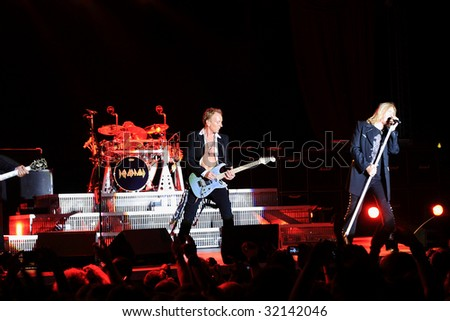 DUBLIN - JUNE 12 : Joe Elliot (R) and Phil Collen (L) of Def Leppard rock group on stage during their 2009 tour at The O2 Dublin June 12, 2009 in Dublin.