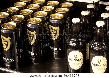 DUBLIN-MAY 29 2011:Bottles and cans of Guinness for sale. Guinness is one of the worlds most successful beers selling over 18 million pints worldwide every year.Dublin May 29 2011