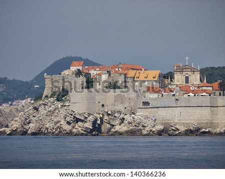 Dubrovnik city wall front view from the sea - stock photo