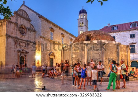 DUBROVNIK, CROATIA - JULY 19: Night scene in the old town of Dubrovnik, Croatia, featuring the Big Fountain of Onofrio, one of the old town landmarks build in 1444 as imaged on July 19, 2015. - stock photo