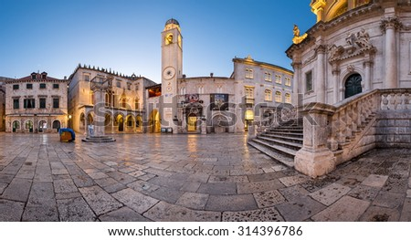 DUBROVNIK, CROATIA - JULY 1, 2014: Panorama of Luza Square and Sponza Palace in Dubrovnik. In 1979, the city of Dubrovnik joined the UNESCO list of World Heritage Sites.