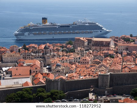 DUBROVNIK, CROATIA - JULY 16: The Costa Favolosa cruise ship passes very close to the old town walls, in Dubrovnik, Croatia on July 16, 2011 - stock photo