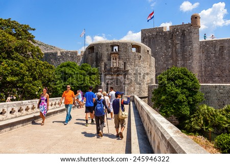 DUBROVNIK, CROATIA - JULY 19: Unknown tourists near at the Pile Gate, on July 19, 2014 in Dubrovnik, Croatia. The Pile Gate is one of the entrance through the wall of the historic center of Dubrovnik. - stock photo