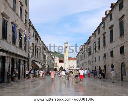 DUBROVNIK, CROATIA - JUNE 05, 2016: Old town of Dubrovnik (Stari grad) with sightseeing tourists on the limestone paved Stradun street