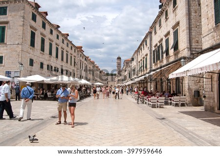 DUBROVNIK, CROATIA - JUNE13, 2010: Summer scene of the main street (Stradun or Placa), with locals and tourists, in Dubrovnik, Croatia