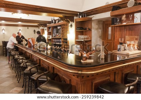 DUBROVNIK, CROATIA - MAY 28, 2014: Bartender and guests at local irish pub. - stock photo