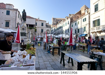 DUBROVNIK, CROATIA - OCT 24, 2012: Busy day at Dubrovnik's market. On 24 Oct 2012 in Dubrovnik, Croatia. - stock photo