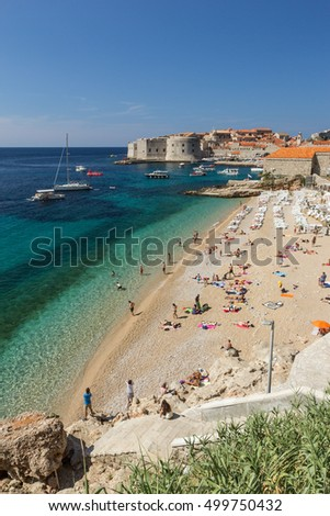 DUBROVNIK, CROATIA - SEPTEMBER 8, 2015: People at the Banje Beach next to Dubrovnik's Old Town in Croatia.