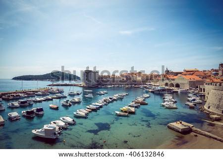Dubrovnik old medieval harbor in bay. Croatia. - stock photo