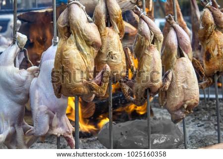 Duck turkey chicken sajji food street stock photo royalty free duck and turkey chicken sajji at food street karachi pakistan indian recipe masala chicken forumfinder Image collections