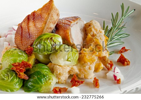Duck breast and brussel sprouts served at a restaurant - stock photo