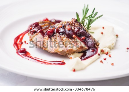 duck breast with mashed potato - stock photo