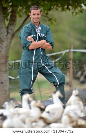 Duck breeder standing outside the farm - stock photo