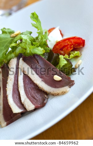 Duck ham and salad on a plate