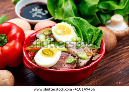 Duck noodles with egg, vegetables and duck meat in bowl - stock photo