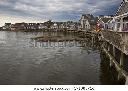 DUCK, NORTH CAROLINA - MAY 2, 2014:  The Waterfront Shops in Duck offer a unique shopping experience over the water of the currituck Sound in the Outer Banks of North Carolina. - stock photo