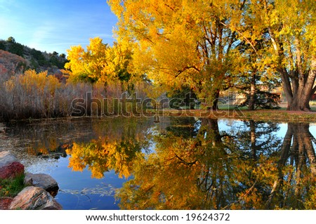 Duck Pond at Rockledge Ranch near Colorado Springs, Colorado in the Autumn with brilliant colorful reflection - stock photo