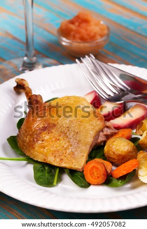 Duck with spinach, potato, apple sauce and carrot
