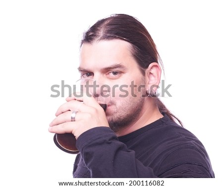 Dude drinking beer, studio shot - stock photo