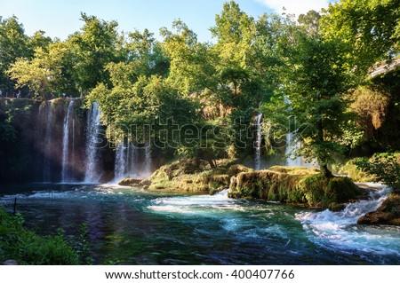 Duden waterfall Antalya, Turkey. Waterfall surrounded by forest. Waterfall stream. Panoramic view on Duden Waterfall. Summer waterfall stream. Waterfall surrounded by forest. Summer waterfall forest - stock photo