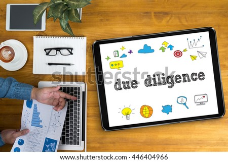 due diligence  Businessman working at office desk and using computer and objects, coffee, top view, - stock photo