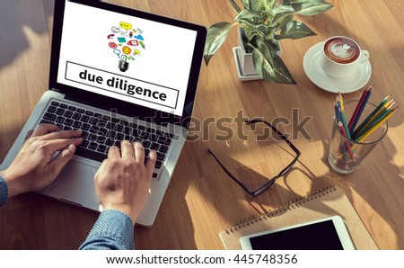 due diligence  man hand on table Business, coffee, Split tone - stock photo