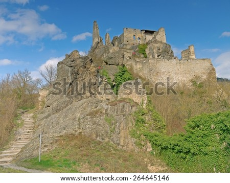DUERNSTEIN, AUSTRIA - 28 March 2015: The castle in Duernstein was built in the 12th century. According to legend king Richard the Lionheart was imprisoned in the castle.  - stock photo