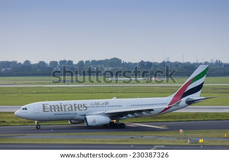 DUESSELDORF, GERMANY - SEPTEMBER, 25, 2011: Airbus A330 of Emirates rolling to gate after landing. This aircraft is a wide-body twin-engine jet airliner with a seating capacity of about 250. - stock photo