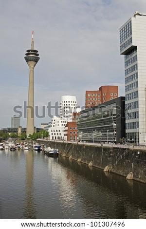 Duesseldorf Harbour with Rheinturm (Rhine Tower) - stock photo