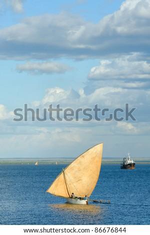Dugout canoe, back the the harbour, mahajanga - stock photo