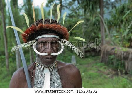 DUGUM DANI VILLAGE,  IRIAN JAYA, NEW GUINEA, INDONESIA - JUNE 20: Dugum Dani Warrior  Portrait. June 20, 2012 The Baliem Valley Papua or Irian Jaya Indonesian New Guinea - stock photo