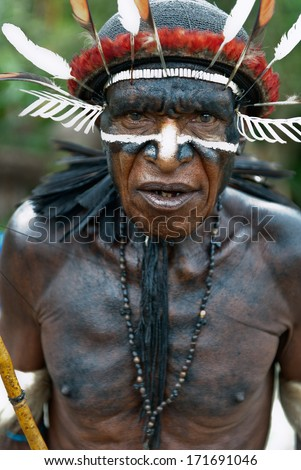 DUGUM DANI VILLAGE, IRIAN JAYA, NEW GUINEA, INDONESIA - JUNE 20: Dugum Dani Warrior Portrait. June 20, 2012 The Baliem Valley Papua or Irian Jaya Indonesian New Guinea  - stock photo
